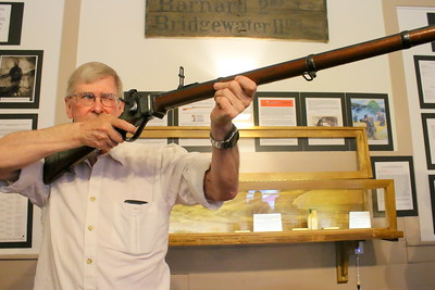 IMG_5884 darrell thompson of norwich, with rifle he donated