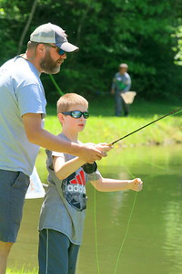 IMG_3249 brian burkholder of barnard,,and with Trout Unlimted, helps dominick Dooman,10,,learning to cast a fly rod