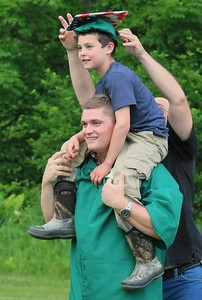 IMG_8482 hunter balch gives jesse magner,,9, a ride, while dad jeremy magner puts hat on his sons head