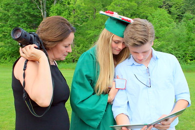 IMG_8434 emma maiden shows her diploma to andy sieple