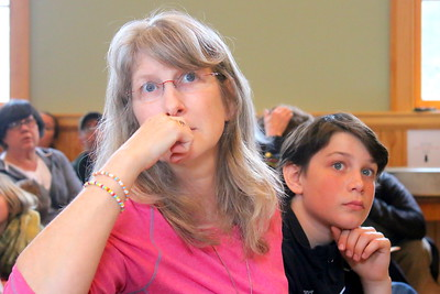 IMG_3017 valerie LaCroix and her son michael,11, listen to act 46 debate