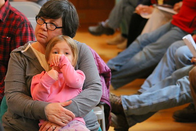 IMG_3113 sherry doton holds Aoife edmunds,3, on her lap during act 46 debate
