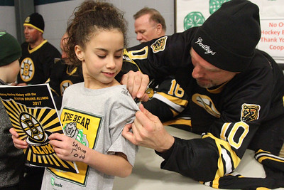 PHOTO BY HERB SWANSON:            Ken Hodge signs his autograph on Lexi Mosher's shirt  at the Boston Bruins Alumni vs  Union Arena Bears game at Union Arena  in Woodstock, Vermont on Saturday, February 25, 2017. http://herbswanson.smugmug.com/