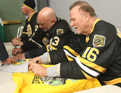 PHOTO BY HERB SWANSON:      Dan Lacouture (L) Ken Linesman (M) and Rick Middleton sign autographs  at the Boston Bruins Alumni vs the Union Arena Bears game at Union Arena  in Woodstock, Vermont on Saturday, February 25, 2017. http://herbswanson.smugmug.com/