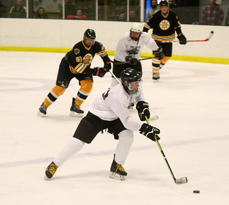PHOTO BY HERB SWANSON:          Bill Ware takes the puck down the ice  during the the Boston Bruins Alumni vs the Union Arena Bears game at Union Arena  in Woodstock, Vermont on Saturday, February 25, 2017. http://herbswanson.smugmug.com/