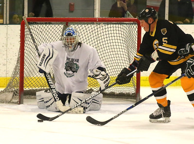 PHOTO BY HERB SWANSON:      Dan Wong keeps his eyes on the puck as Bruins Alumni Mike Sanford controls the puck  during the the Boston Bruins Alumni vs the Union Arena Bears game at Union Arena  in Woodstock, Vermont on Saturday, February 25, 2017. http://herbswanson.smugmug.com/