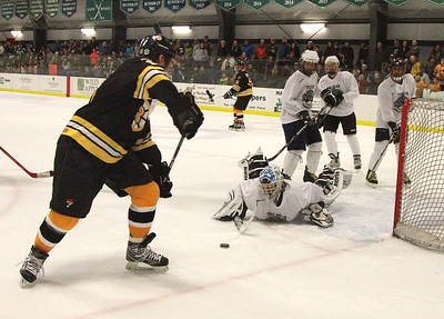 PHOTO BY HERB SWANSON:      Bruins Ken Hodge shoots against goalie Dan Wong  during the the Boston Bruins Alumni vs the Union Arena Bears game at Union Arena  in Woodstock, Vermont on Saturday, February 25, 2017. http://herbswanson.smugmug.com/