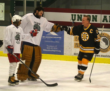 PHOTO BY HERB SWANSON:      Rick Middleton (R) greets Dan Wong and Kenedi Hall  before the start of the Boston Bruins Alumni vs the Union Arena Bears game at Union Arena  in Woodstock, Vermont on Saturday, February 25, 2017. http://herbswanson.smugmug.com/