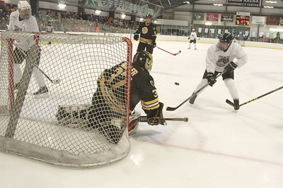 PHOTO BY HERB SWANSON:       Bruins  Shawn Miller deflects a shot on goal   during the the Boston Bruins Alumni vs the Union Arena Bears game at Union Arena  in Woodstock, Vermont on Saturday, February 25, 2017. http://herbswanson.smugmug.com/
