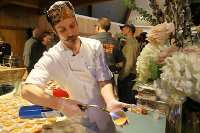 IMG_5703 raymond barnard, of Simon Pearce, carmelizes  some maple cream brulee