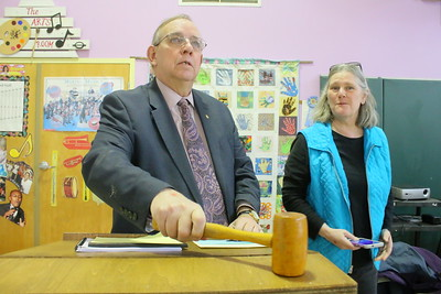 IMG_2021 Moderator Jon Springer calls the meeting to order,,town clerk and treasurer Calista Brennan at right