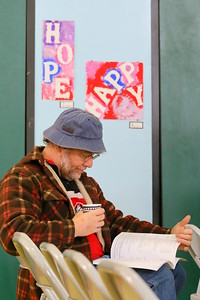 IMG_2001 Steve Moore reads town report before meeting starts