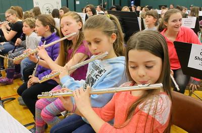 IMG_4198 georgia tarleton at left, and hannah gubbins at center,  and hannah watson, at right , play flute