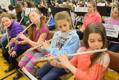 IMG_4185 georgia tarleton, on left, and hannah gubbins, hannah watson at right of prosper valley, play flute in rehearsal