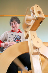 IMG_0393 janet andersen, spinning wool from her own Border Leicster sheep,, leader of FAB,,,Fiber Arts Barnard