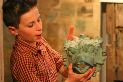 IMG_2062 levi Halley,,holds up a gargoyle face that used to be on the Mackenzie fountain at center of village,,during Woodstock Aqueduct presentation