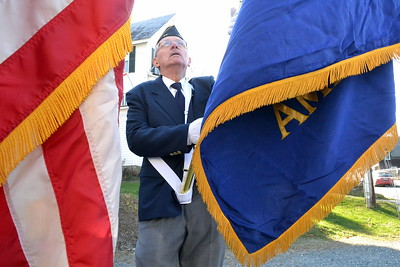 DSC_0015 dick roy  unfurls the blue legion post flag