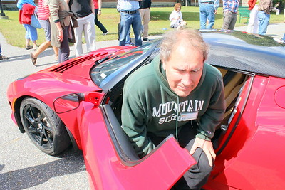 IMG_4475 six foot tall Henry Sharp of thetford gets out of his 2011 Tesla Roadster, with a seat hieght of just six inches,,car is very high performance