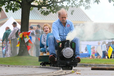 IMG_4562 graham portnoy,5, of white river, rides a 1 5 inch scale steam train, built and driven by michael McClure, of Railroad Supply, of nashua, nh