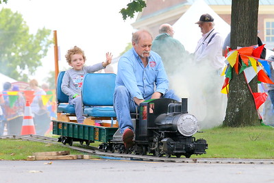 IMG_4556 graham portnoy,5, of white river,,rides a 1 5 inch scale steam  train built and driven by Michael McClure, of Railroad Supply, of nashua nh