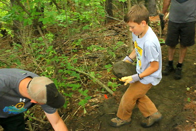 IMG_5616 chase gravelle, 10, brother of ashley,,brings a rock to fill in a hole on edge of trail
