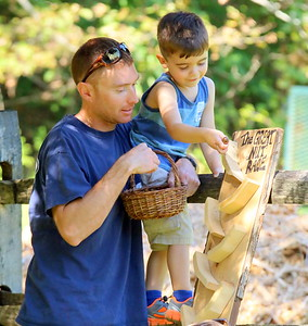 IMG_7524 asher Galusha3, and his dad sean, drop an acorn down the Great Nut Race game