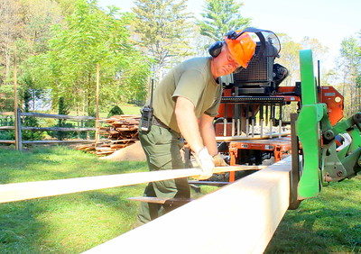 IMG_7508 kyle jones, resource manager at MBRNP, helps richard wright of white river with his portable sawmill