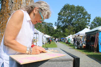 IMG_5021eanne Amato, of woodstock,,,showing the process of how she makes wood block prints
