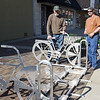 Bob Kelly installs new bike rack in Downtown Terre Haute in front of the Century 21 Offices