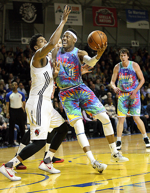 . The Santa Cruz Warriors rocked their tie-dye uniforms in a Febuary game against the Windy City Bulls. (Dan Coyro -- Santa Cruz Sentinel)