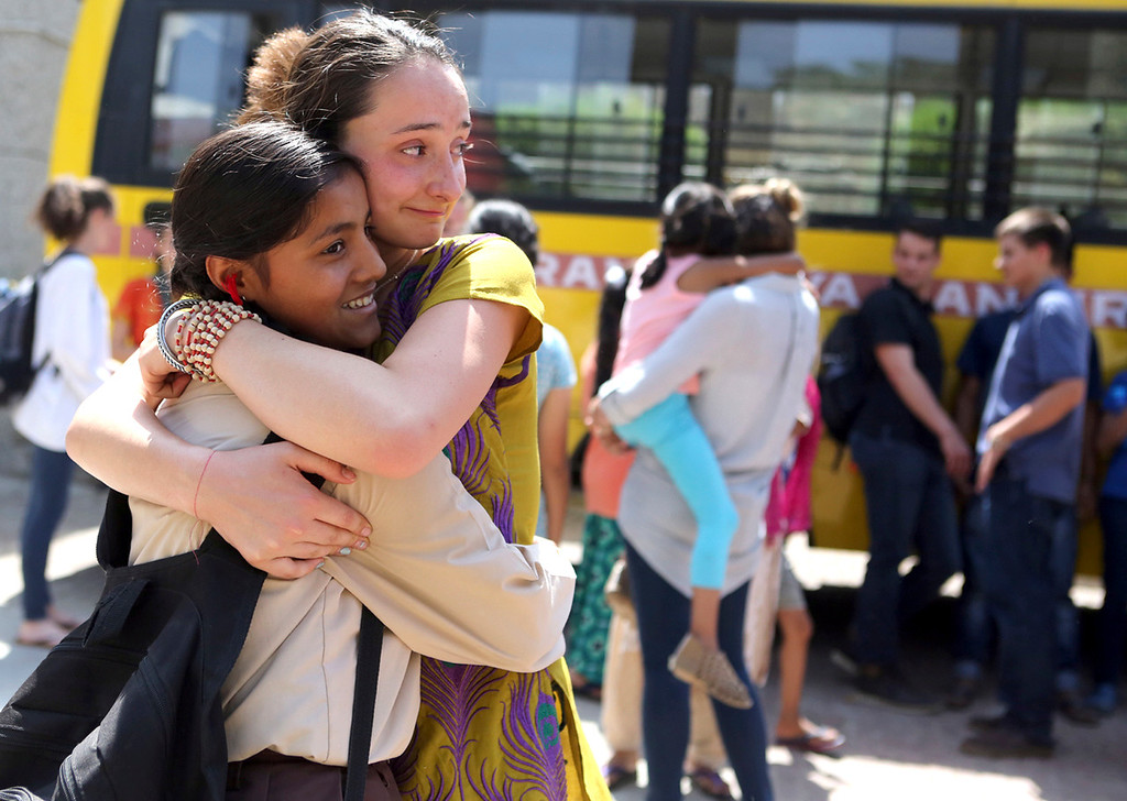 . Mount Madonna School senior Bella Bettencourt tars up as she hugs newfound friend Madhu Sharan as Bettencourt and her classmates from Watsonville, California leave Sri Ram Ashram near Haridwar, India on April 3, 2017. The Mount Madonna students were on a two-week learning journey in India.