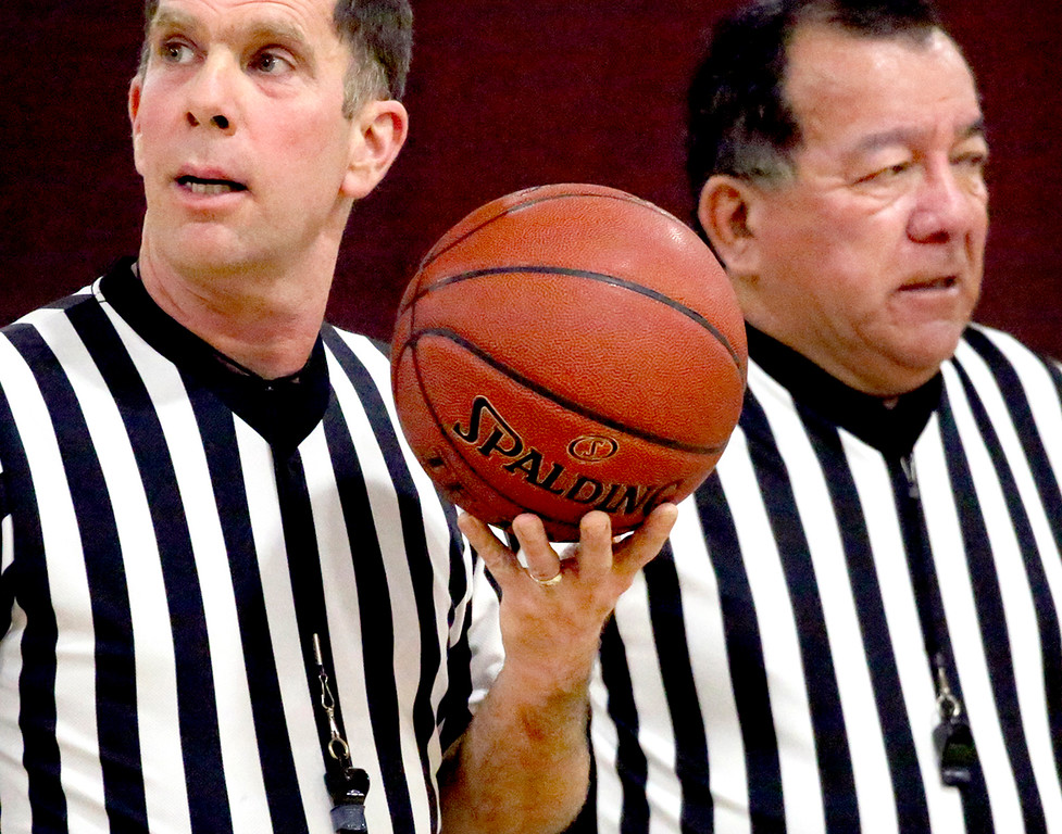 . Referees Billy Healy and Frank Paz appear to be conjoined during a time out at the Santa Cruz Coast Athletic League game between the Scotts Valley High School and Aptos High School girls� varsity teams in Scotts Valley, California on Tuesday January 3, 2017.