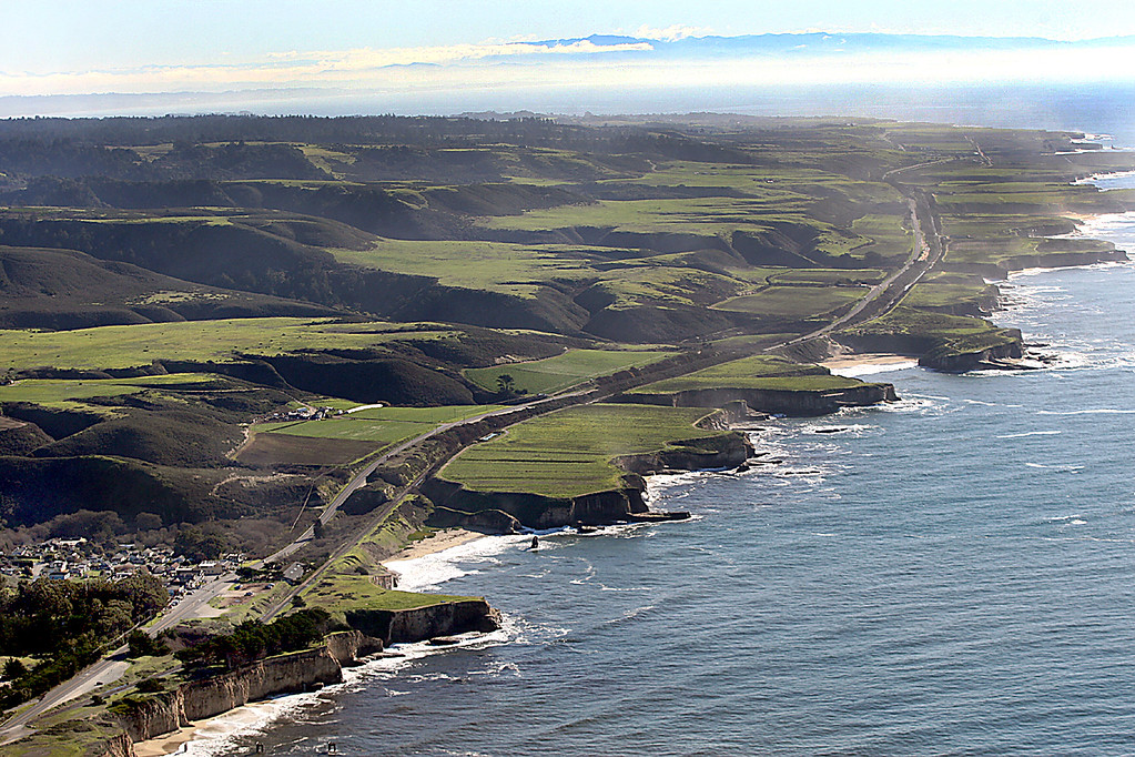 . Looking down the coast from Davenport, at lower left, the Cotoni-Coast Dairies National Monument comprises most of the visible land from Highway 1 leading into the hills (flight courtesy of LightHawk).  (Dan Coyro -- Santa Cruz Sentinel)