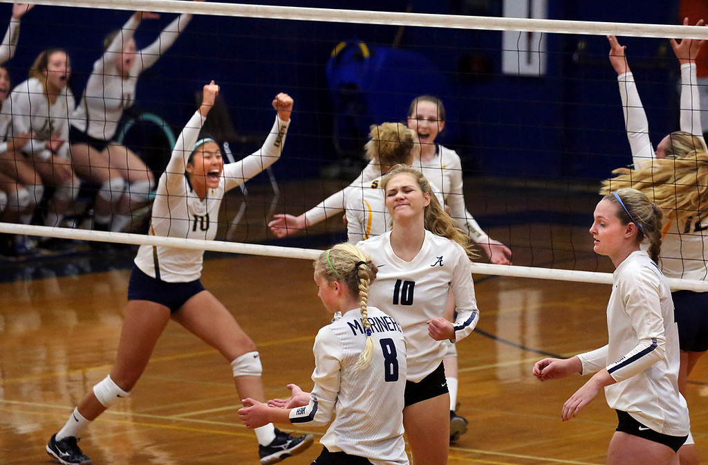 . Aptos High players find themselves in the unusual place of falling behind in a volleyball match as the Soquel High team exults after a hard-fought point on Tuesday September 19, 2017 at Soquel high School in Soquel, California. Soquel, a perennial runner-up in the Santa Cruz Coast Athletic League to Aptos won the match and holds sole possession of first place.