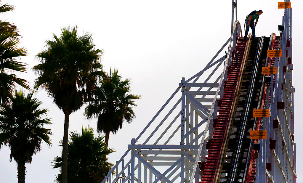 . Roller coaster mechanic Ernes completes the daily safety check on the tracks of the Giant Dipper, the wooden roller coaster opened at the Santa Cruz Beach Boardwalk in 1924. The Boardwalk\'s \'Coaster Crew\' makes these checks on all the rides before opening each day. (Shmuel Thaler -- Santa Cruz Sentinel)