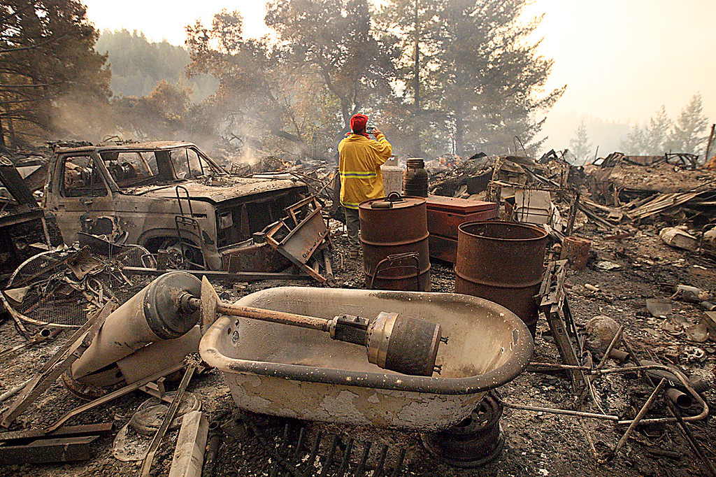 . A house at the end of a road off Bear Creek Canyon Road is totally destroyed along with a number of vehicles, trucks, generators and construction equipment after the Bear Fire roared through inthe pre-dawn hours of Tuesday. (Dan  Coyro -- Santa Cruz Sentinel)