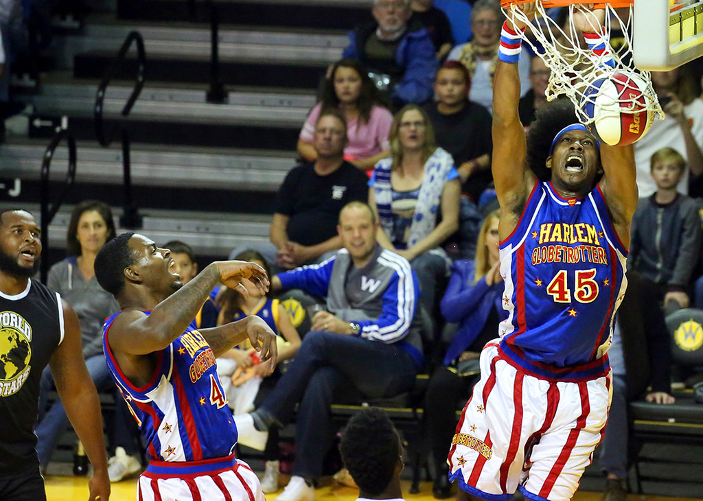 . For players like �Moose� and the entire Harlem Globetrotters, the evening at Kaiser Permanente Arena in Santa Cruz was about entertaining the crowd with gravity-defying dunks, a bit of comedy and spectacular basketball. (Shmuel Thaler � Santa Cruz Sentinel)