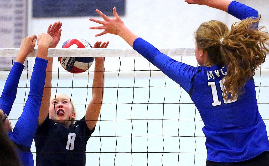 . Monte Vista Christian middle blocker Allie Tillery, right, puts away a point for the Mustangs as Dani Hewitt guards the net for Aptos High on Thursday August 24, 2017 at Aptos High School in Aptos, California. MVC won the non-league match 3-1.