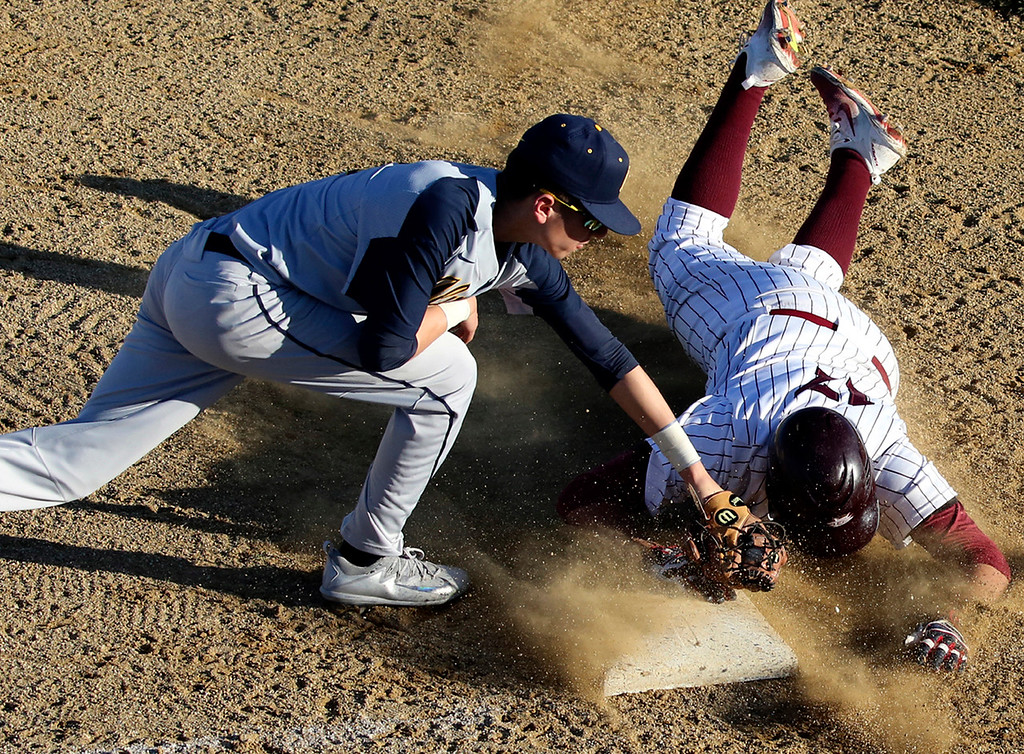 . St. Francis senior Andrew Ciandro slides into third with a triple under the tag of Alvarez third baseman Danny Aguillon Thursday. (Shmuel Thaler -- Santa Cruz Sentinel)