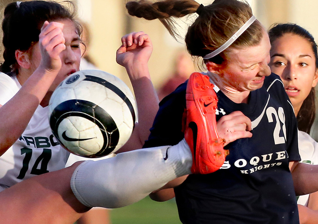 . Soquel High School sophomore Savannah Burcher is inadvertently kicked in the head as Harbor\' Highs Sadie Collins boots the ball from near the goal during Soquel\'s 2-0 victory Thursday January 12, 2017 at Depot Park in Santa Cruz, California. Burcher stayed in the game.
