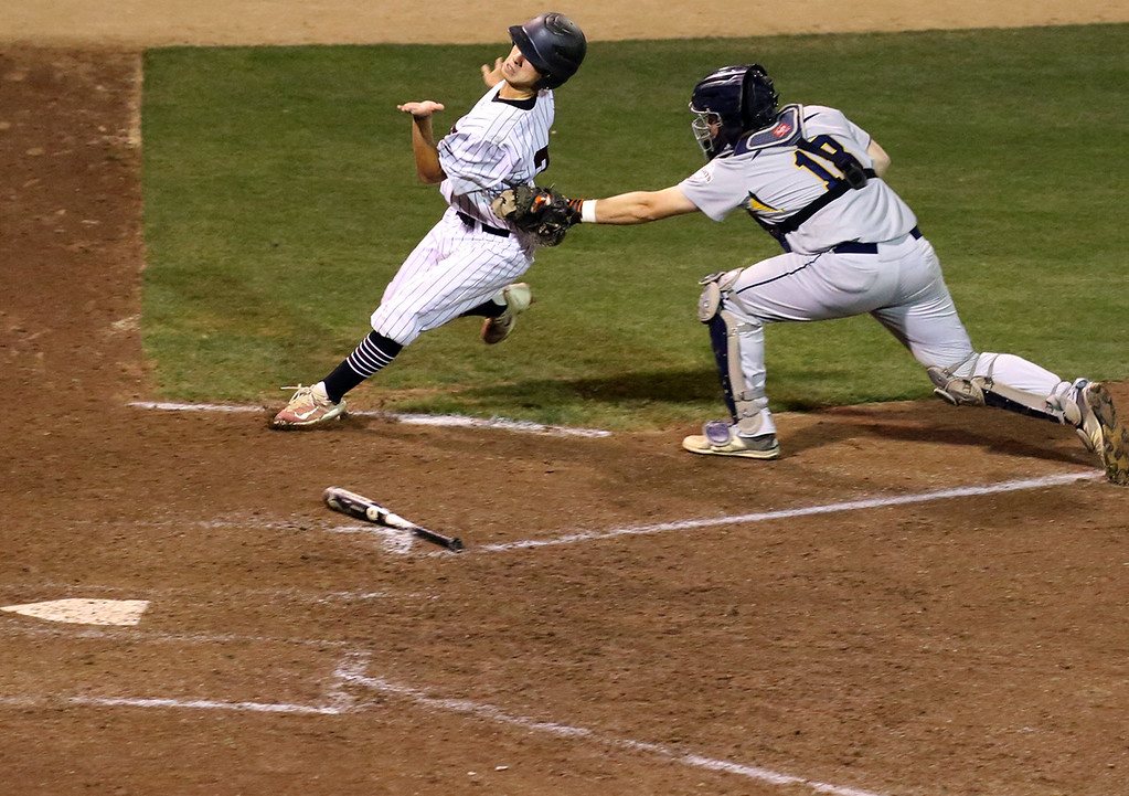 . St. Francis runner Andrew Seymour is tagged out by Menlo School catcher Ben Somorjai in the bottom of the sixth inning during a Central Coast Section playoffs semi-final game at San Jose Municipal Stadium in San Jose, California on Tuesday May 23, 2017. Menlo won the game to advance to the championship.