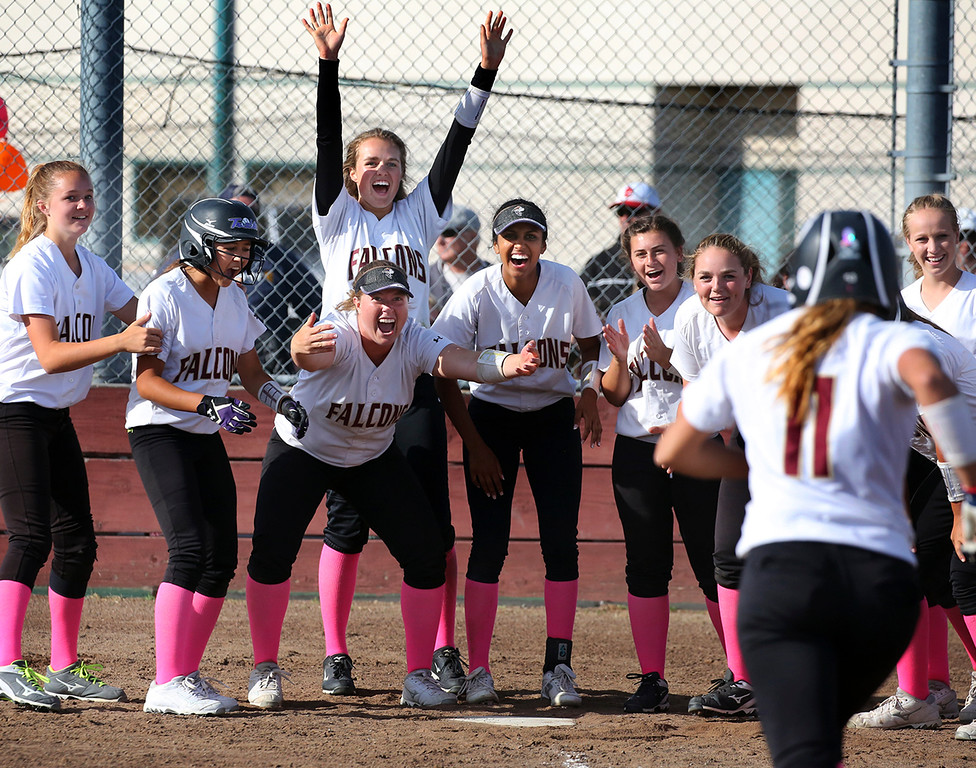 . The Scotts Valley High softball team celebrates at home plate as Lauren LaHood rounds the bases after smashing a 2-run walk-off home run to right field in the seventh inning to defeat San Lorenzo Valley 5-3 on Wednesday May 10, 2017 in Scotts Valley, California.