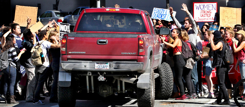 . Protesters blocking the intersection of Pacific Avenue and Mission Street hold their ground after a man intentionally drove his truck into the crowd Wednesday. (Shmuel Thaler -- Santa Cruz Sentinel)