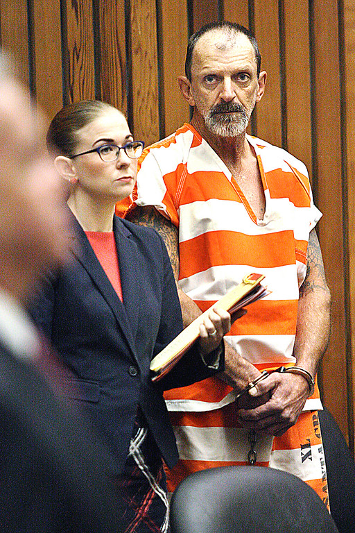 . Marlon Coy listens to District Attorney Jeff Rosell explain the four felony arson charges leveled against Coy, who is charged with starting the Bear Fire in the Santa Cruz Mountains.  Coy is standing next to attorney Sarah Schumacher during his arraigment Tuesday in Judge John Salazar\'s courtroom. (Dan  Coyro -- Santa Cruz Sentinel)