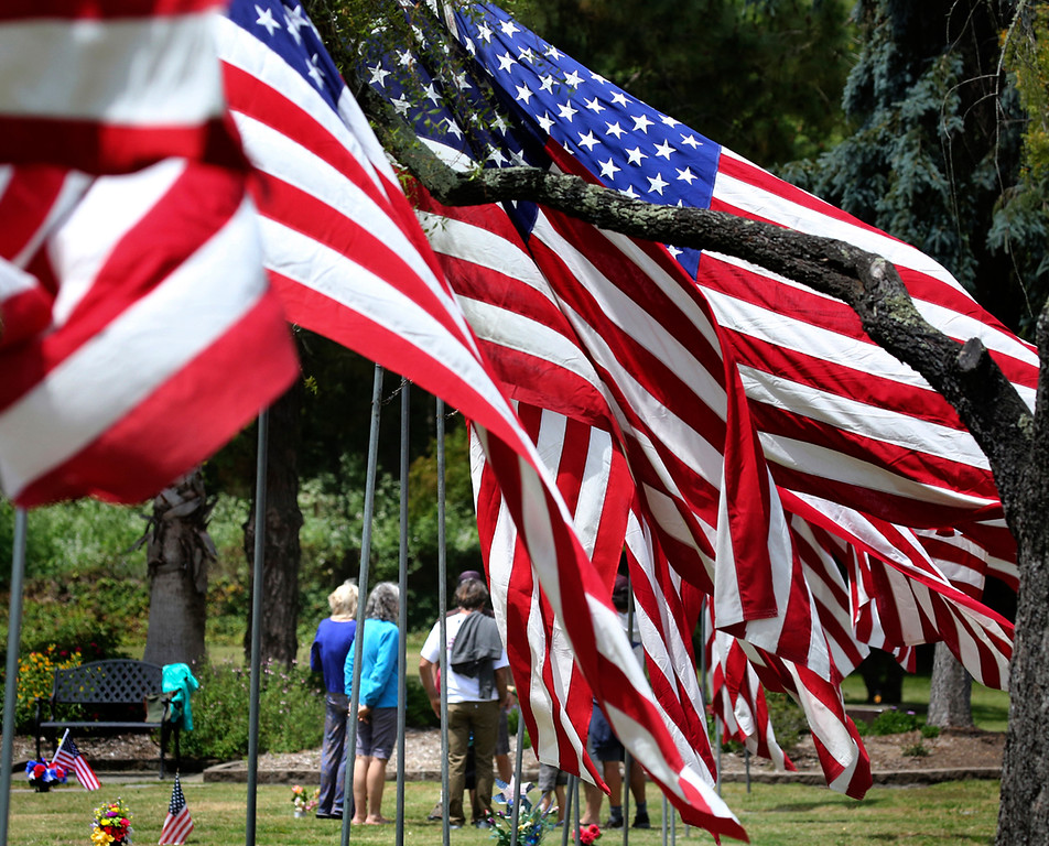 . The family of Lawrence and Eileen Walsh gather along the Avenue of Flags at Santa Cruz Memorial Park in Santa Cruz, California on Memorial Day at the graves of the WWII United States Navy veteran and his wife on Monday May 29. 2017. Lawrence Walsh, who served as a Navy Seabee, died in 1997 and his wife passed away a decade later.