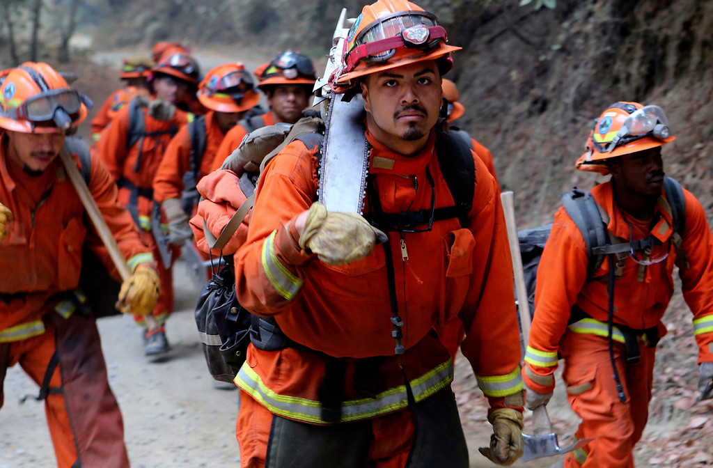 . A California Department of Corrections and Rehabilitation fire crew heads up Bear Creek Canyon Road as they assist on the fire lines of the Bear Fire near Boulder Creek, California on Wednesday October 18, 2017.