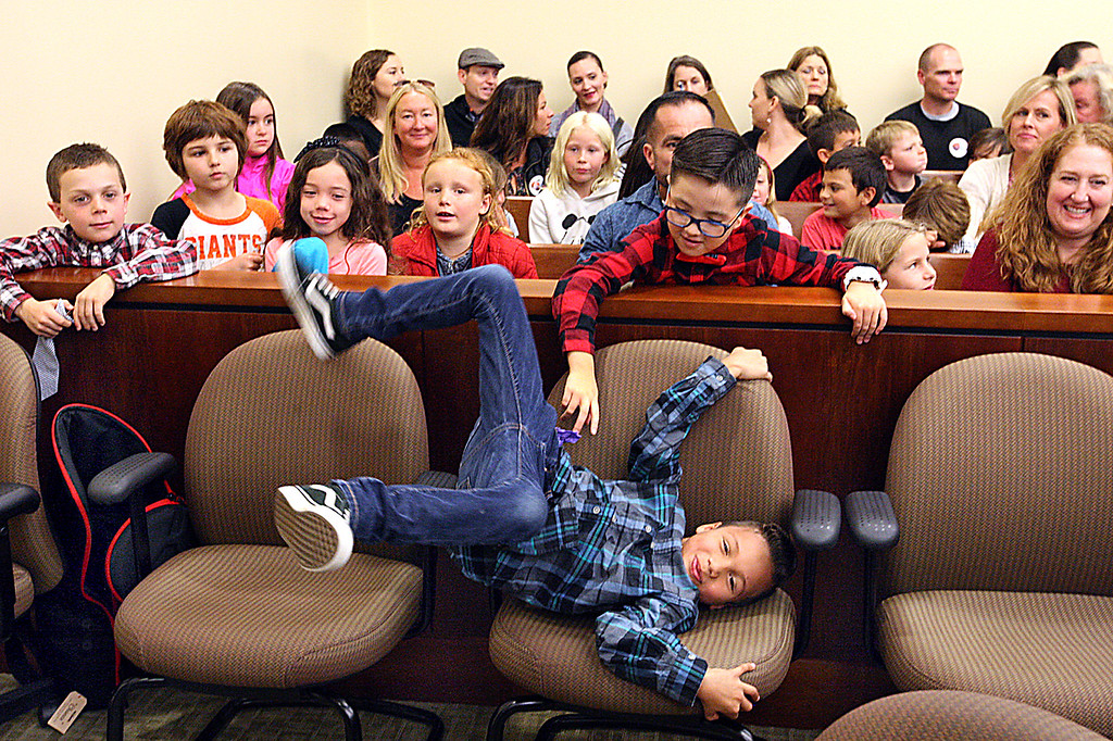 . Weston is pretty excited that all his classmates at Mar Vista Elementary showed up in court to watch the adoption ceremony in Judge Rebecca Connolly\'s courtroom Friday. (Dan  Coyro -- Santa Cruz Sentinel)