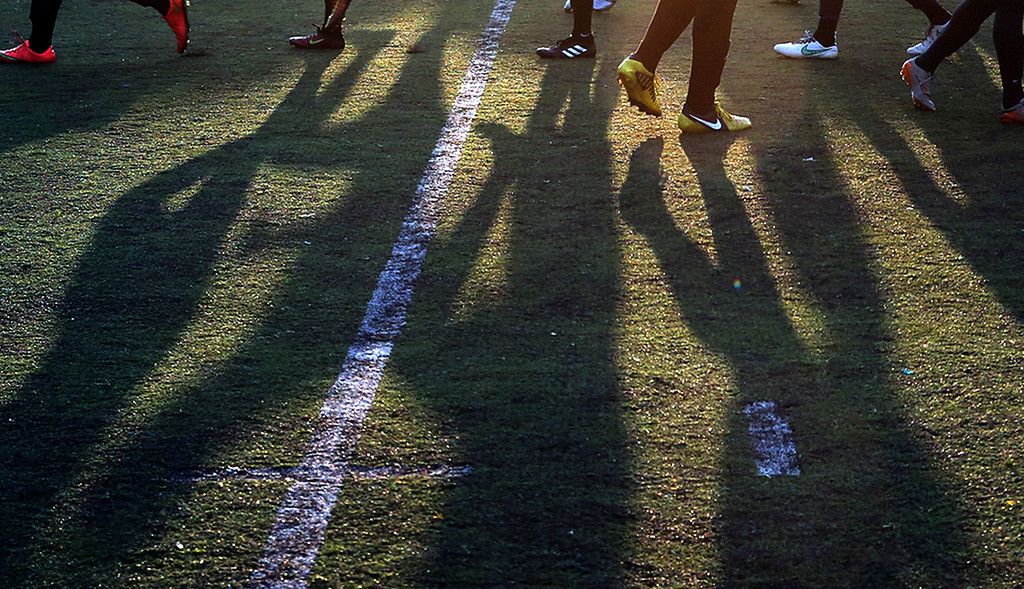 . The last sunlight of the day casts long shadows as the players on the Cabrillo College men\'s soccer team goes through their pre-game warmups before a home scrimmage against UC Santa Cruz Tuesday.