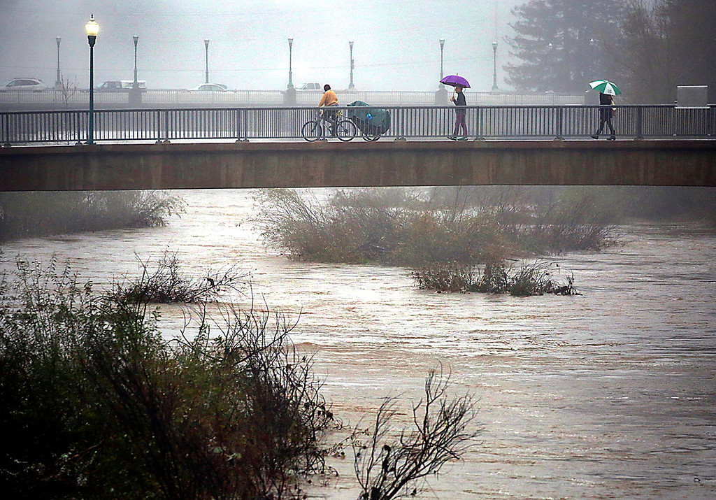 . The rain-swollen San Lorenzo River flows through downtown Santa Cruz, California on Wednesday January 4, 2017.
