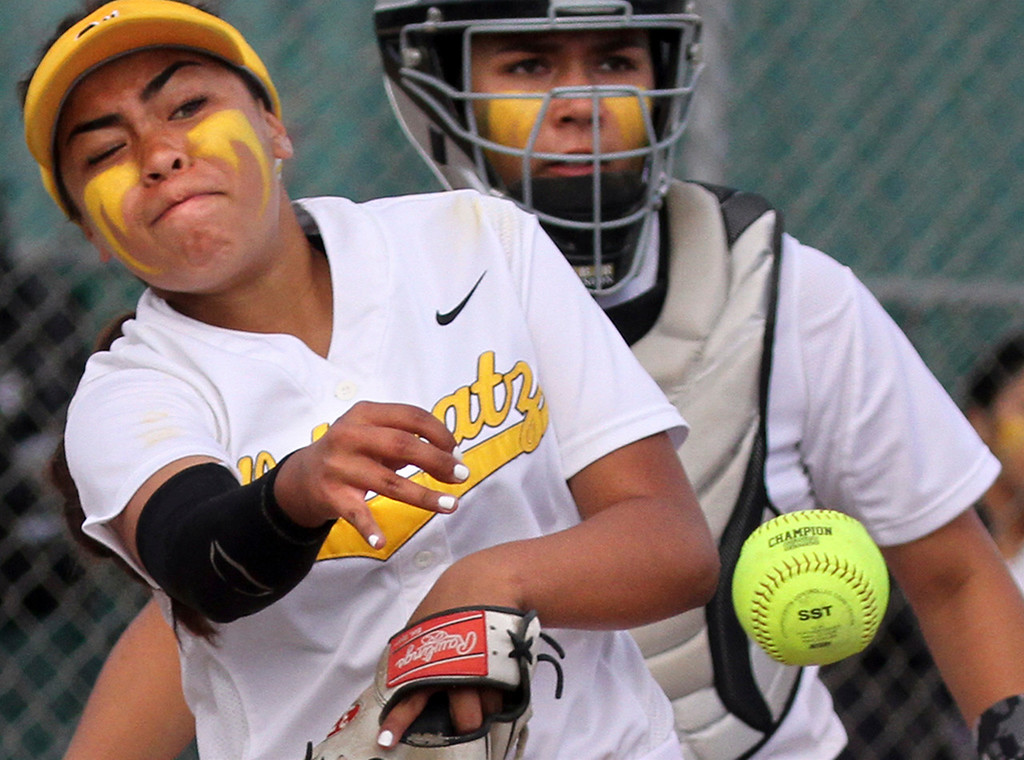 . Watsonville pitcher Jessica Rodriguez throws out a Notre Dame runner as catcher Juliana Wilson backs up the play Tuesday. Wilson pitched a complete game, but took the 3-1 loss. (Shmuel Thaler � Santa Cruz Sentinel)